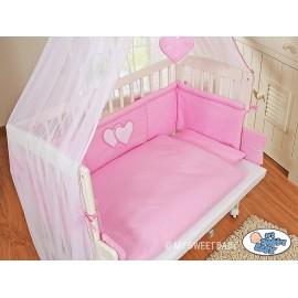 Lit bébé cododo avec parure coeur rose